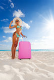 Beautiful woman with suitcase on vacation Royalty Free Stock Photos