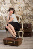 Beautiful woman with suitcases Stock Photography