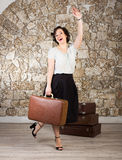 Beautiful woman with suitcases Stock Image