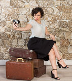 Beautiful woman with suitcases Stock Photo