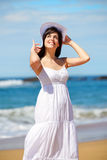 Beautiful woman on summer beach vacation Stock Photography
