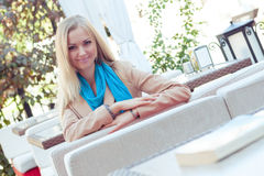 Beautiful woman in a summer cafe Stock Photos