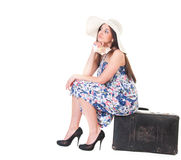 Beautiful woman in summer dress with hat, case and money Royalty Free Stock Images