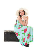 Beautiful woman in summer dress with hat, case and money Stock Photo
