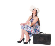Beautiful woman in summer dress with hat, case and money Royalty Free Stock Photography