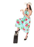 Beautiful woman in summer dress with hat, case and money Stock Images