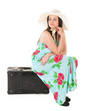 Beautiful woman in summer dress with hat, case and money Royalty Free Stock Image