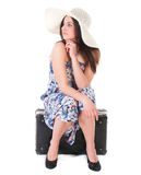 Beautiful woman in summer dress with hat and case Stock Photos