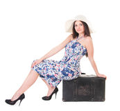 Beautiful woman in summer dress with hat and case Royalty Free Stock Images
