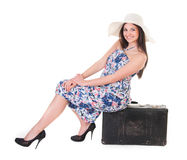 Beautiful woman in summer dress with hat and case Stock Image