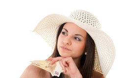 Beautiful woman in summer dress with hat and money Stock Image