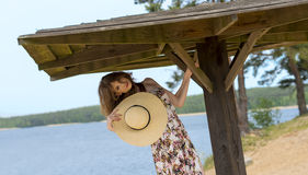 Beautiful woman in summer dress and hat near the lake Stock Photography