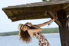 Beautiful woman in summer dress looking in camera Stock Photo