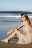 Beautiful Woman In Summer Dress Sitting On Sandy Beach Royalty Free Stock Images
