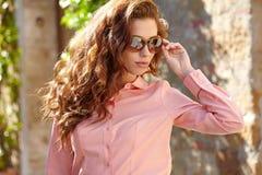 Beautiful woman in summer dress walking and running joyful and c Royalty Free Stock Photos