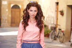 Beautiful woman in summer dress walking and running joyful and c Royalty Free Stock Image