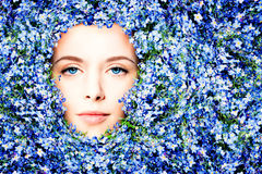 Beautiful Woman in Summer Flowers Background. Female Face with Make up Royalty Free Stock Photo