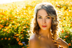 Beautiful Woman on Summer Flowers Background Royalty Free Stock Photos
