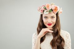 Beautiful woman in summer flowers wreath. Pretty model with red lips makeup and cute smile portrait.  stock images