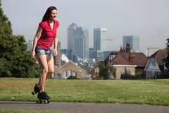 Beautiful woman summer fun roller skating London Stock Photography