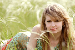 Beautiful woman at summer meadow background Royalty Free Stock Images