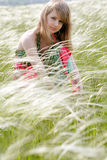 Beautiful woman at summer meadow background Stock Images