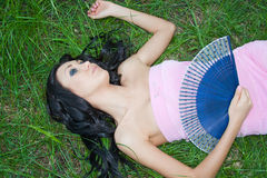 beautiful woman in summer on nature lies on a green gras Royalty Free Stock Photography
