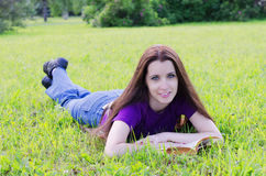 The beautiful  woman in a summer park Stock Photography
