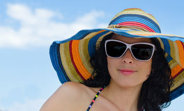 Beautiful woman in a summer sunhat Stock Photos