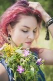 Beautiful woman with summer wild flowers bouquet Stock Photo
