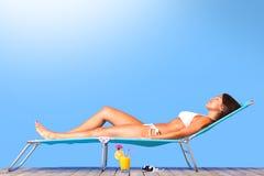 Beautiful woman sunbathing royalty free stock photo