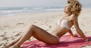 Beautiful Woman Sunbathing On A Beach Royalty Free Stock Photography