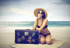 Beautiful woman sunbathing on the beach Stock Photography