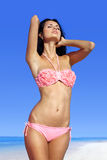 Beautiful woman sunbathing on beach Stock Image