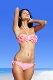 Beautiful woman sunbathing on beach Stock Image