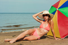 Beautiful woman sunbathing on a beach. Royalty Free Stock Photos