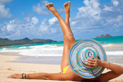 Beautiful woman sunbathing on a beach Stock Photography