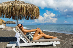 Beautiful woman sunbathing on a lounger Stock Image