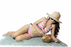 Beautiful woman sunbathing on the mat Royalty Free Stock Images