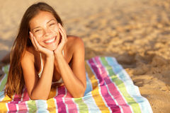 Beautiful Woman Sunbathing On The Beach Royalty Free Stock Images