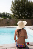 Beautiful woman sunbathing on the pool, back view Royalty Free Stock Photo