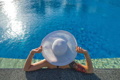 Beautiful woman sunbathing by the pool top view horizontal. Summ. Er background Royalty Free Stock Photos