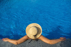 Beautiful woman sunbathing by the pool top view horizontal. Summ. Er background Stock Photos
