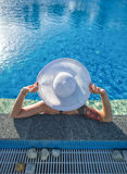 Beautiful woman sunbathing by the pool top view horizontal. Summer. Background Royalty Free Stock Images