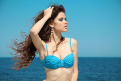 Beautiful woman sunbathing at the seaside Stock Photography