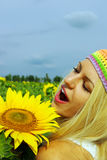 Beautiful woman with a sunflower Stock Image