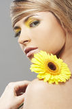Beautiful woman with a sunflower royalty free stock photos
