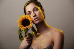 Beautiful woman with a sunflower Stock Photo