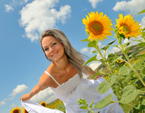 Beautiful woman on sunflower field Stock Photography