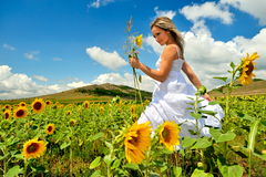 Beautiful woman on sunflower field Royalty Free Stock Photography